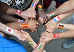 hands with international flags