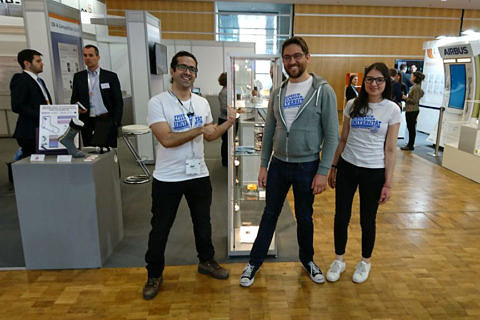 The FAU Team, consisting of Amir Y. Amin, Niall Kilillea and Dimitra Papadopoulo (from left to right) at the LOPEC fair in Munich. (Image: Mrs. Daria Firlus)
