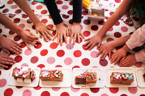 children's hands and sweets