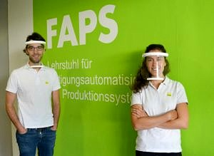 Staff from the FAPS with protective visors.